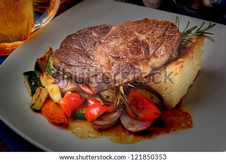 plate with beef steak, different vegetables and lasagna - stock photo