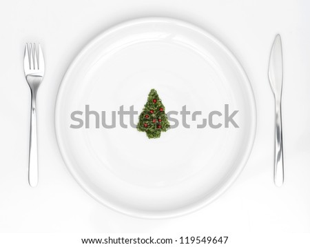 plate with christmas tree of sliced �¢??�¢??onion and red pepper - stock photo