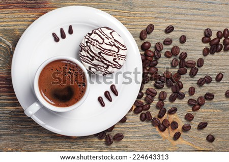 Plate with coffee cup and cookies on vintage wooden table. Top view - stock photo