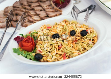 Plate with cold pasta salad - stock photo