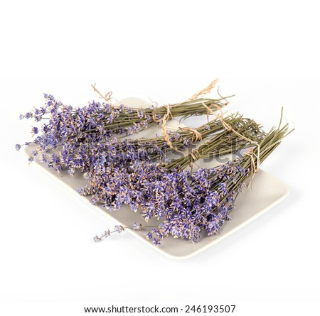 Plate with dry lavender flowers isolated on white - stock photo