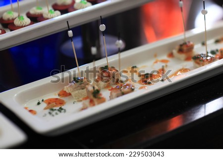 Plate with fish canape at the buffet - stock photo