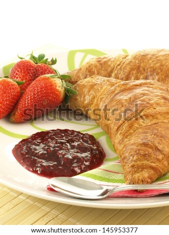 Plate with french croissants and jam for breakfast - stock photo
