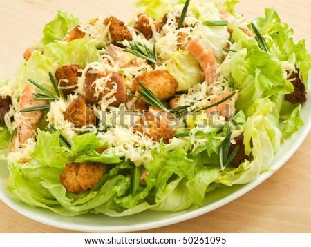 Plate with fresh caesar salad. Shallow dof. - stock photo