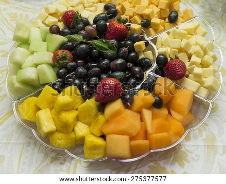 Plate with fruits and cheese - stock photo