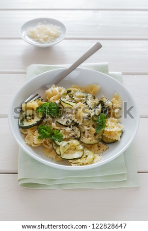 Plate with gluten free pasta and zucchini. - stock photo