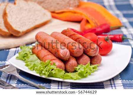 Plate with hot sausages - stock photo