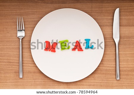 Plate with letters on the white background - stock photo