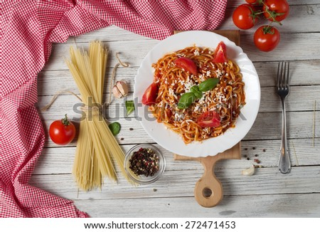 plate with pasta and  ingredients on wood background texture - stock photo