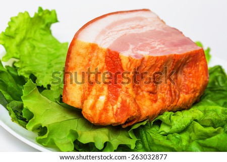 Plate with pork brisket and salad isolated on white background - stock photo