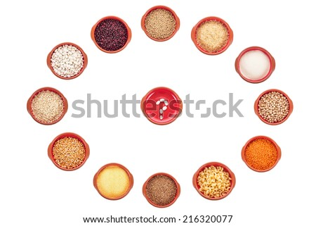 Plate with question mark and different types of groats isolated on white - stock photo