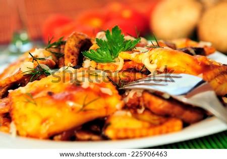Plate with ravioli and champignon - stock photo