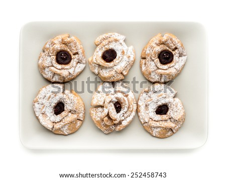 Plate with six crispy cookies with caster sugar and marmalade shot from above - stock photo