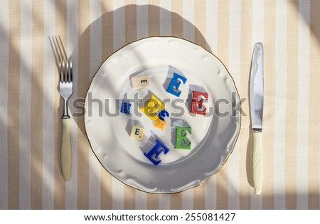 Plate with unhealthy foods with preservatives - stock photo