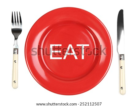 Plate with word EAT on it, fork and knife isolated on white - stock photo