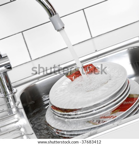 Plates in the sink - stock photo