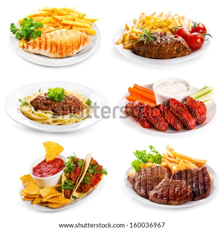 plates of various meat and chicken on white background - stock photo
