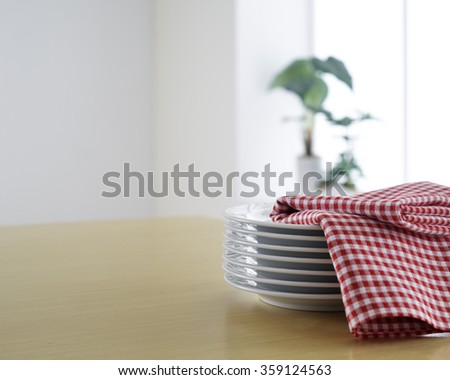 plates on wooden table - stock photo