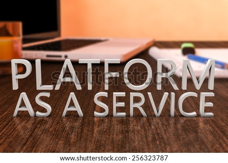 Platform as a Service - letters on wooden desk with laptop computer and a notebook. 3d render illustration. - stock photo