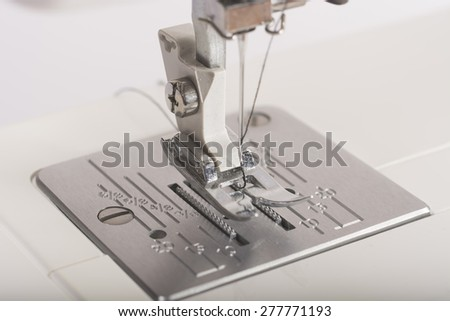 platform of the sewing machine needle and pad - stock photo