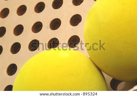 platform paddle balls and fiberglass paddle - stock photo