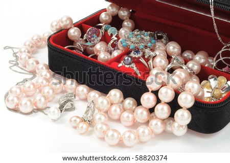 Platinum and pearl jewelry in open box, close up - stock photo