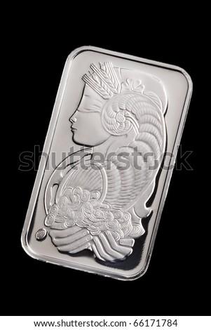 Platinum ingot on black background - stock photo