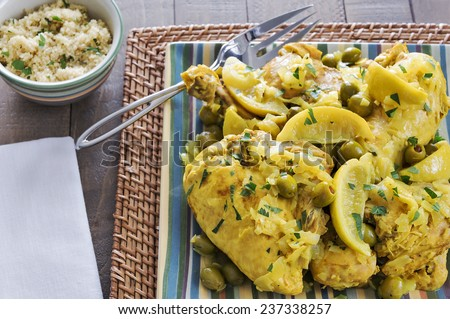 Platter full of Moroccan Chicken served with Couscous - stock photo