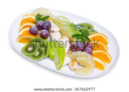 Platter of a assorted fresh fruits in long white plate, isolated with clipping path - stock photo
