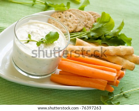 Platter of assorted fresh vegetables and cookies with dip - stock photo