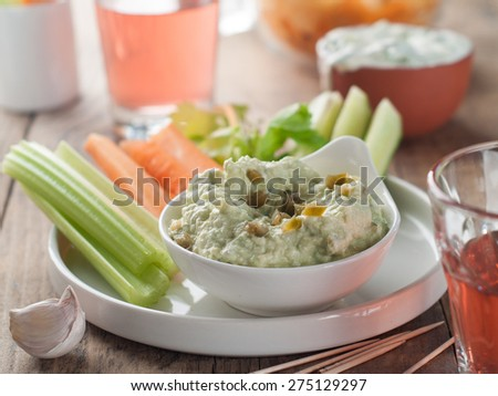 Platter of assorted fresh vegetables with dip, selective focus - stock photo