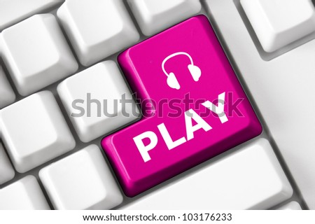 Play text and headphone symbol on the modern keyboard. Concept - stock photo