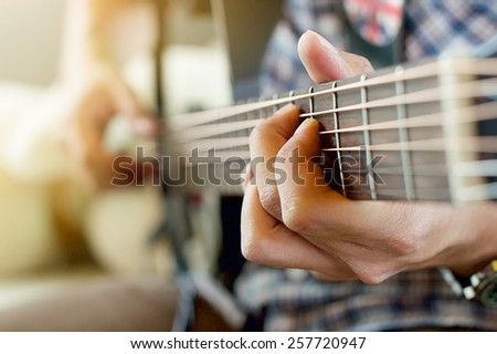 play the guitar - stock photo