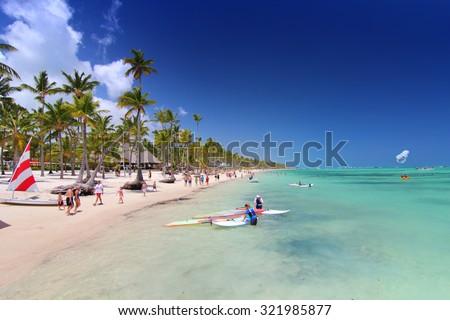 Playa Bavaro, Dominican Republic- April 19, 2015: Preparing for water sport activities - stock photo
