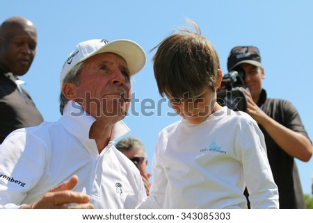 PLAYER, GARY - NOVEMBER 15: Tournament presenter Gary Player Playing at his Charity Invitational Golf Tournament with grandson, son of Mark Player on November 15, 2015, Sun City, South Africa.  - stock photo