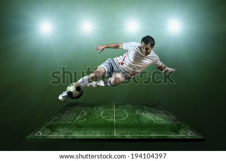 Player in action at the grunge football field. - stock photo