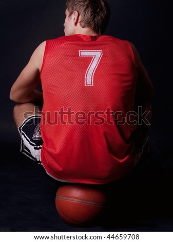 player sitting on the ball - stock photo