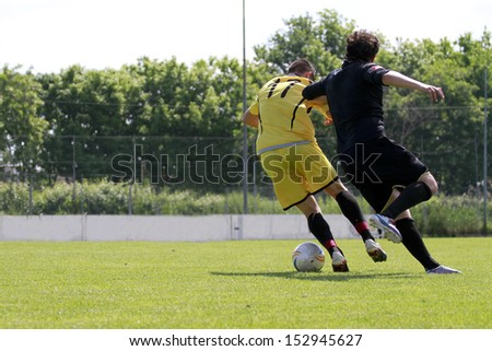 players during a soccer game with ball - stock photo