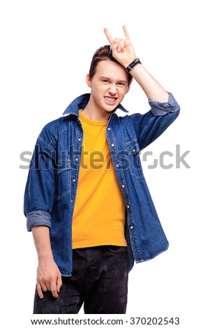 Playful devil. Young grimacing funny man. Isolated on white. - stock photo
