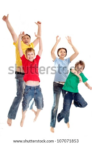 Playful family in bright T-shirts on a white background - stock photo