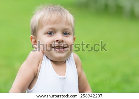 Playful little boy in the park. Boy three years. - stock photo