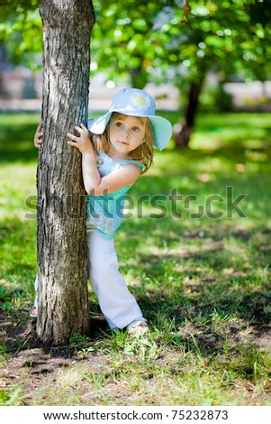 playful little girl  in a summer park - stock photo