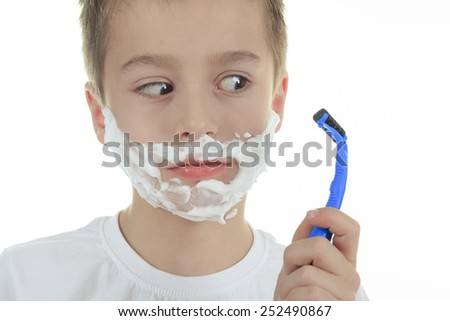playful little young boy shaving face over white background - stock photo