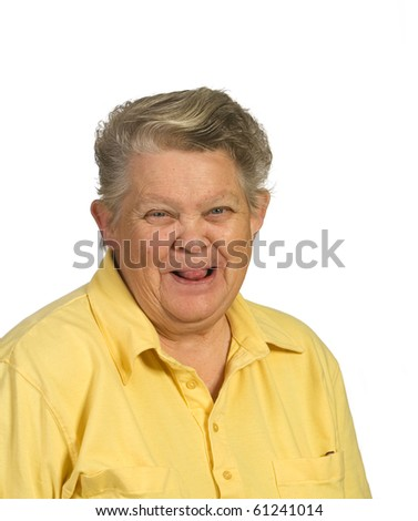 Playful senior woman sticking tongue out. Shot against a white background - stock photo
