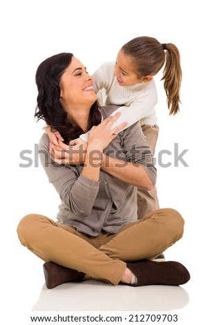 playful young girl hugging mother isolated on white - stock photo