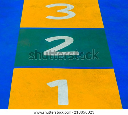Playground flooring as hopscotch - stock photo