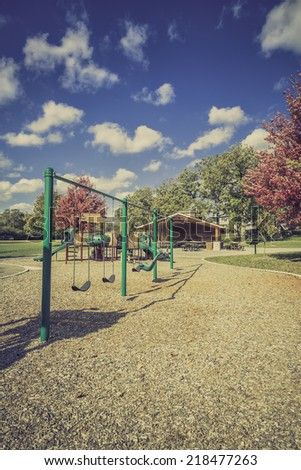Playground  in a park during the autumn season - stock photo