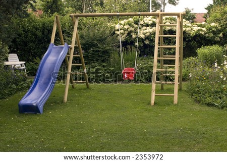 Playground in garden with swing. - stock photo