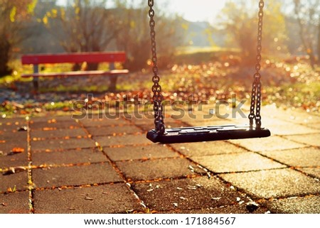 Playground swing in a park - stock photo