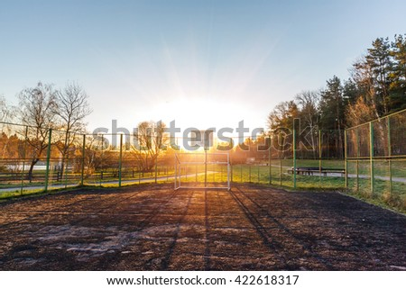 playground with football gates early summer morning in the rays of the rising sun - stock photo